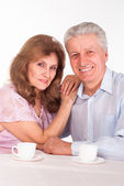 Elderly couple on a white — Stock Photo