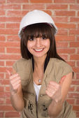 Pretty girl in a helmet — Stock Photo