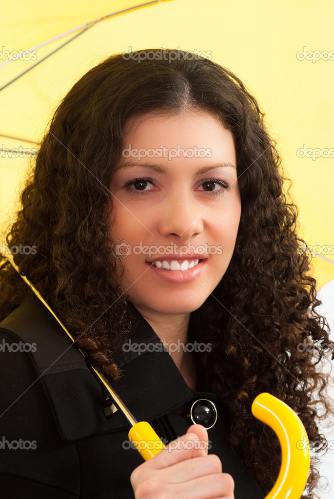 Portrait of a woman with an umbrella on a white background  Stock Photo #5762345