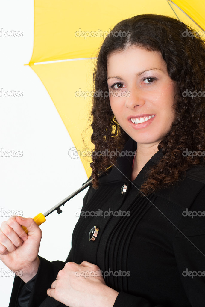 Portrait of a woman with an umbrella on a white background  Stock Photo #5762354