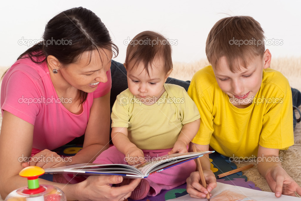 Mom and her children drawing on the carpet  Stock Photo #5763396
