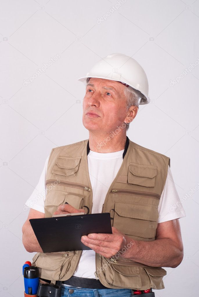 Senior builder writing a list on white — Stock Photo #5766776