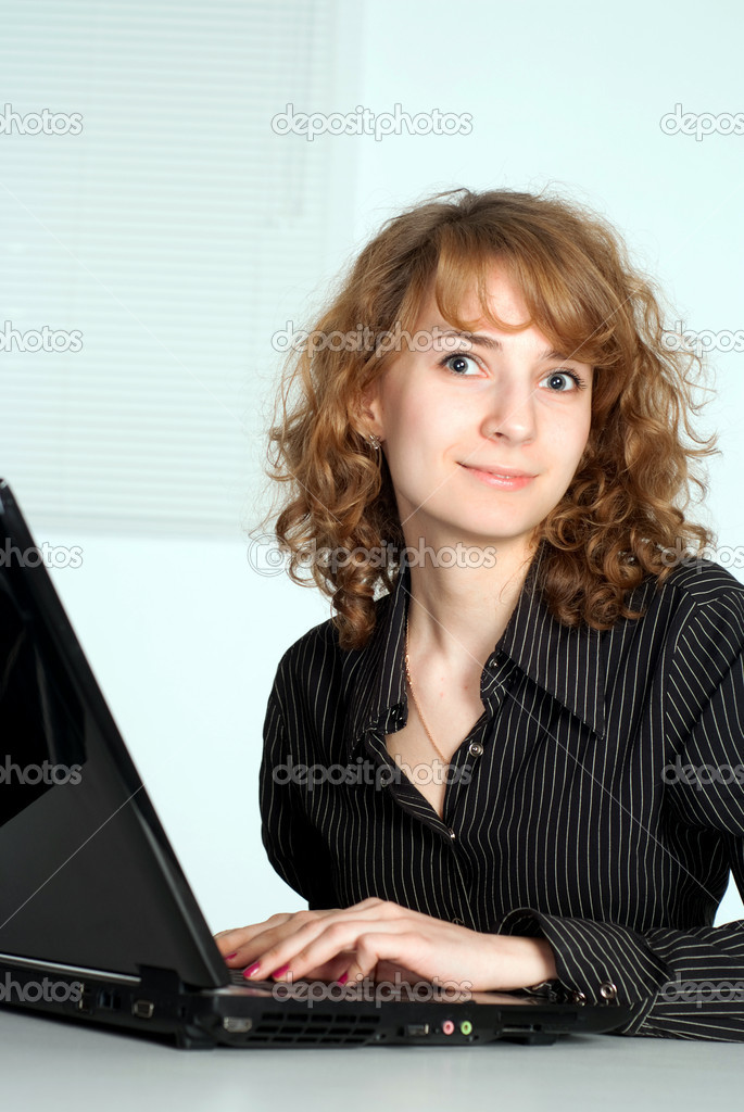 Pretty girl working with a laptop in the office — Stock Photo #5768542