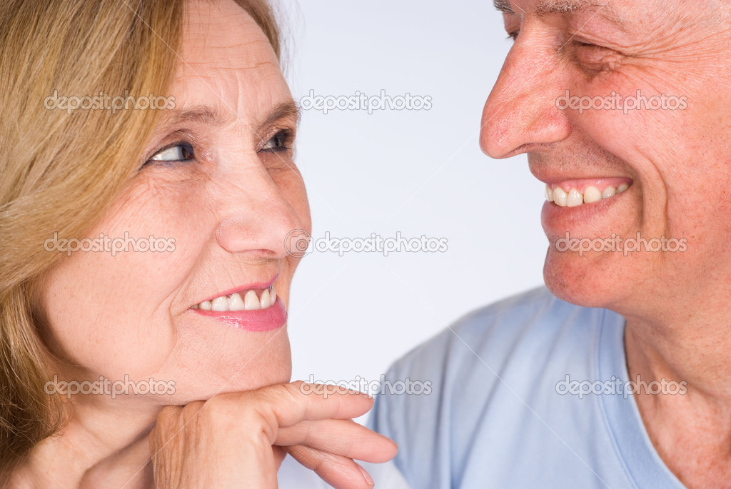 Beautiful elderly couple in a light clothes — Stock Photo #5769847