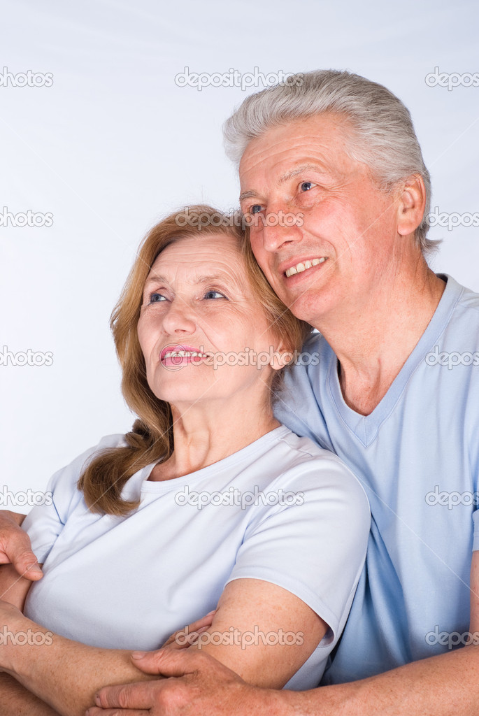 Beautiful elderly couple in a light clothes — Stock Photo #5769850