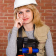 Beautiful builder with stuff - Stock Photo