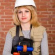Beautiful builder with stuff — Stock Photo