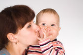 Mom kisses her baby — Stock Photo