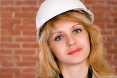 Beautiful builder with helmet — Stock Photo