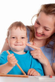 Mom with child drawing — Stock Photo