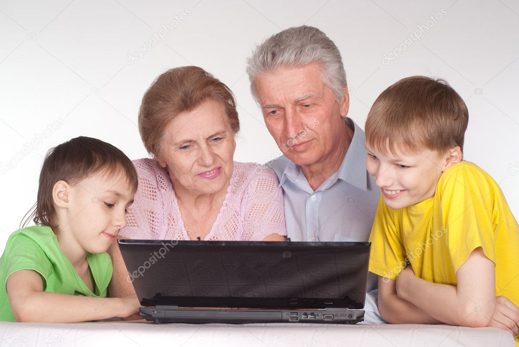Family of a four with a laptop — Stock Photo #5946558