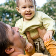 Stock Photo: Smiling dad and baby