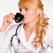 Doctor drinks tea — Stock Photo