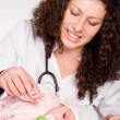 Doctor and baby - Stock Photo