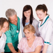 Doctors and a patient — Stock Photo #5951918