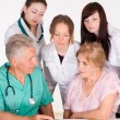 Doctors and a patient — Stock Photo