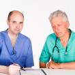Two doctors consulting — Stockfoto