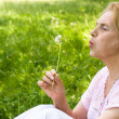 Elderly woman at nature - Stock Photo