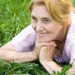Elderly woman at nature — Stock Photo