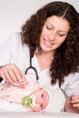 Doctor and baby — Stock Photo