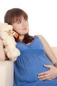 Pregnant girl on sofa — Stock Photo
