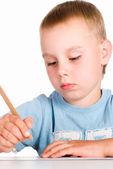 Young boy draws — Stock Photo