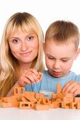 Madre e hijo jugando — Foto de Stock