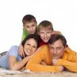 Happy family on a carpet — Stock Photo