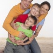Stock Photo: Happy family on a carpet