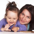 Mom and daughter at table — Stock Photo