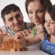 Happy family plays — Stock Photo