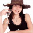 Stock Photo: Girl in hat drinks