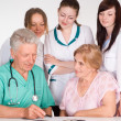 Doctors and a patient — Stock Photo #6024881