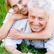 Old couple lying — Stock Photo