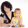 Stock Photo: Mom and kid reading
