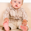 Baby on sofa - Stock Photo