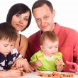 Family plays at table — Stock Photo #6027944