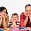 Nice family lying - Stock Photo