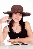 Girl in hat drinks — Stock Photo