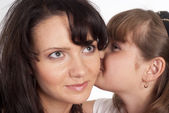 Mom and child whisper — Stock Photo