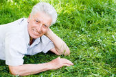 Old man lying — Stock Photo