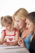 Three girls drawing — Stock Photo