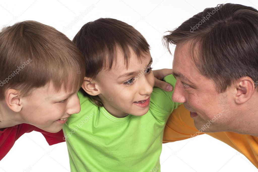 Funny dad and two sons in color shirts — Stock Photo #6022130