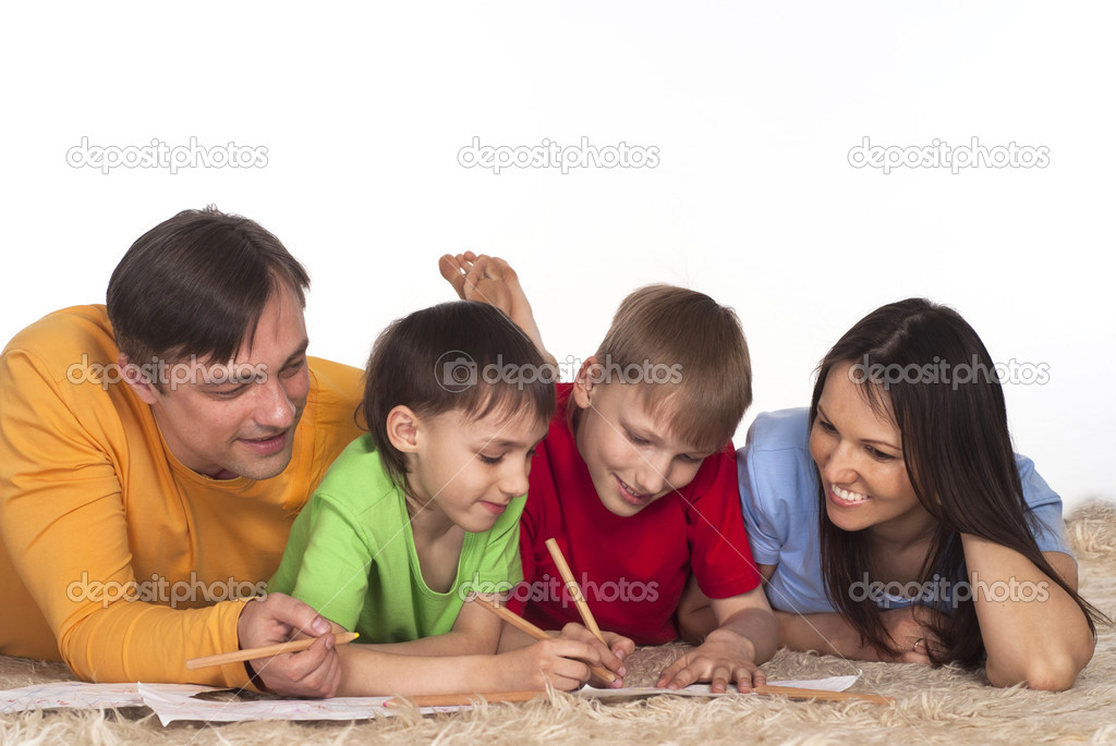 Nice family drawing on a carpet on white — Stock Photo #6022143