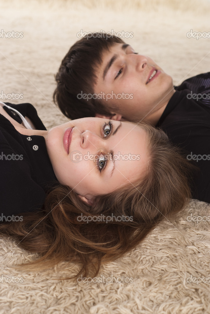 Portrait of a cute young couple on carpet  Stock Photo #6022361