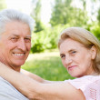 Aged couple at nature — Stock Photo