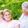 Aged couple lying — Stock Photo
