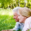 Aged couple lying — Stock Photo #6153761
