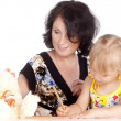 Stock Photo: Mom and daughter draw