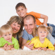 Family on carpet — Foto Stock